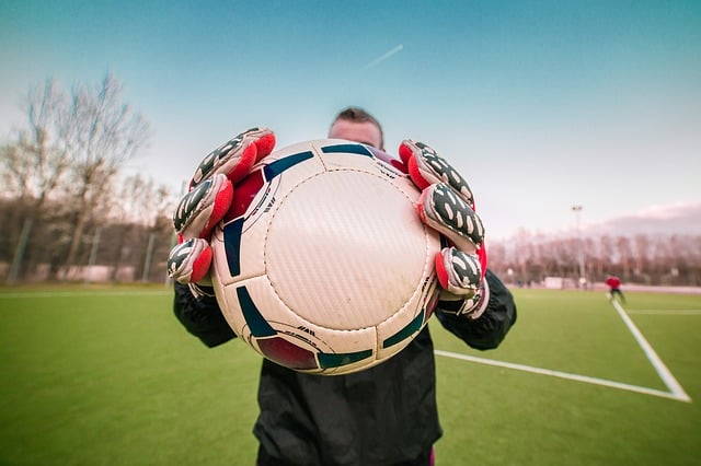 Goalkeeper Gloves Holding Ball