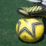Close Up Indoor Soccer Shoe and Ball